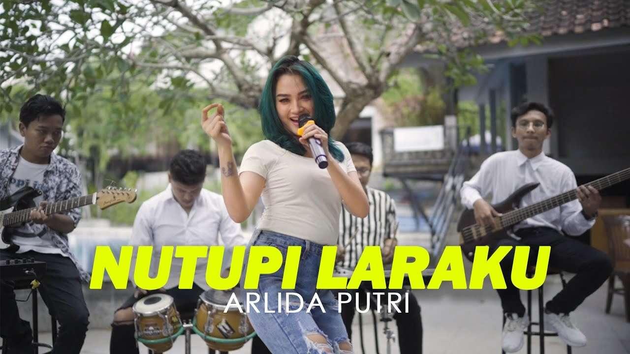 Arlida Putri – Nutupi Laraku (Official Music Video Youtube)